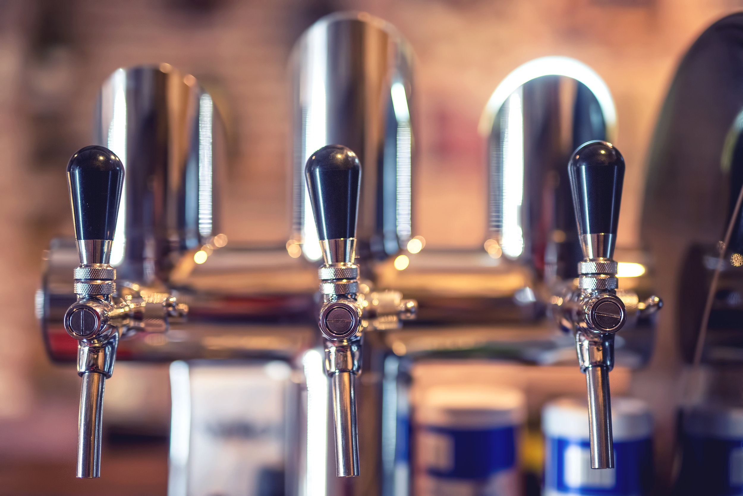 beer tap at restaurant bar or pub close up PS4WTMD